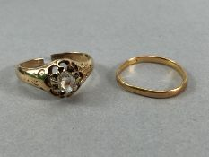Two Gold rings A/F. A gold band hallmarks rubbed approx 1.4g & unhallmarked Gold ring with a