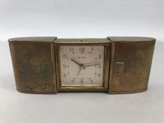Retro ESTYMA brass travel clock 7 jewels with white face and gold batons
