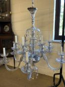 Mid century twelve arm chandelier with glass drops, approx height 105cm and diameter 90cm (A/F)