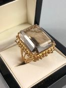 Wire work unmarked Gold ring set with a single large Emerald cut pale yellow Citrine approx.