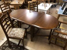 Drop leaf dining table with four ladder back chairs with upholstered seats, including two carvers,