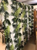 Pair of lined curtains with green fern design on white background. Each curtain approx 157cm wide
