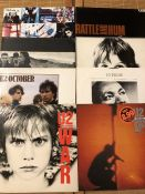"8 U2 LPs/12"" including ""Achtung Baby"", ""Boy"", ""War"", ""October"" etc..."