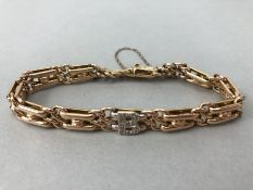 15ct Gold bracelet with diamond encrusted Letter 'B' and safety chain total weight approx 18.7g