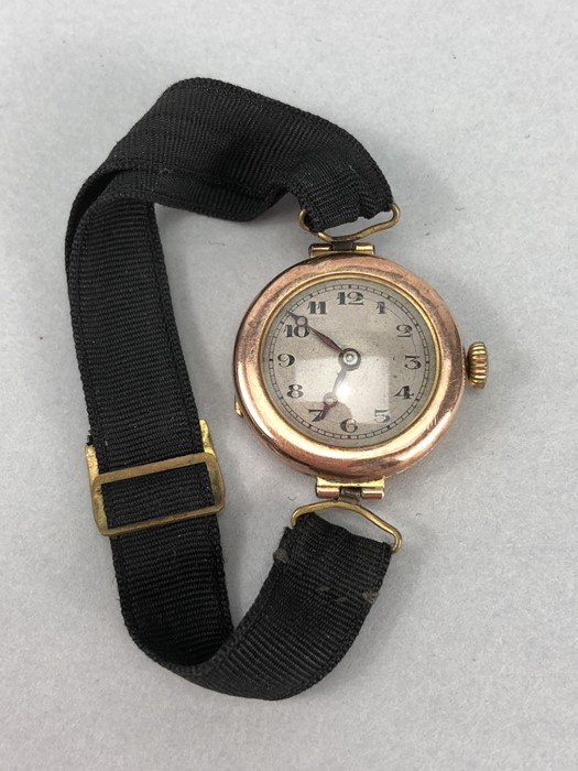 9ct Rose Gold ladies watch with Roman numerals and a fabric strap (total weight 14g)