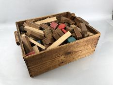 Collection of children's vintage toy building blocks in wooden crate