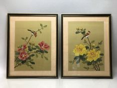 Pair of Chinese silk paintings on green silk depicting Flowers and Birds