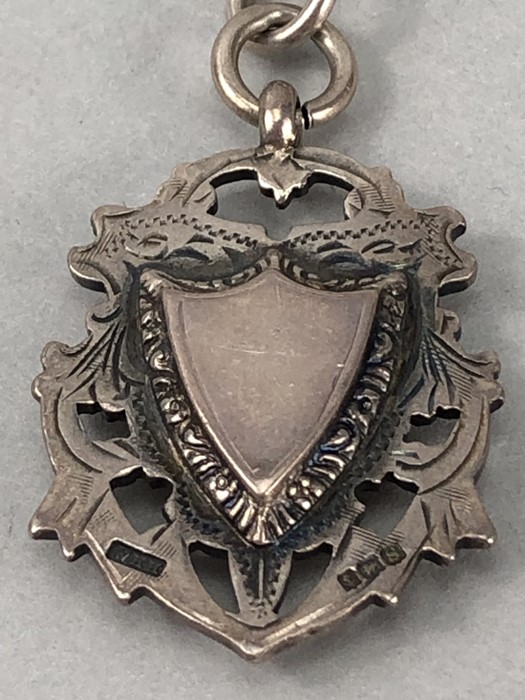 Hallmarked Silver watch chain with hallmarked Albert and a Silver medallion in the shape of a shield - Image 9 of 9