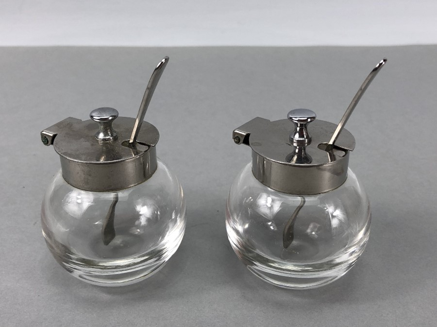 """Pair of circular glass salts with silver coloured lids & Matching spoons marked """"T 18 - 8"""""""