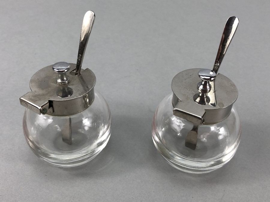 """Pair of circular glass salts with silver coloured lids & Matching spoons marked """"T 18 - 8"""" - Image 2 of 4"""