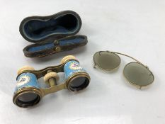 Pair of enamel and brass Opera glasses in original leather case and a pair of gold coloured