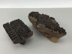 Two carved wooden print blocks with floral design and a frieze design, largest approx 19cm in