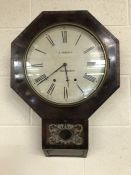 Hexagonal shaped wall clock with pendulum and key by E.Norman of Cheap Street, Sherborne