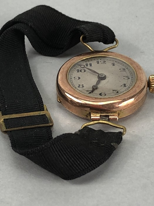 9ct Rose Gold ladies watch with Roman numerals and a fabric strap (total weight 14g) - Image 3 of 4