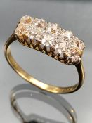 Diamond Ring set with Ten old mine cut Diamonds. Diamonds set in Platinum with 18ct yellow gold ring