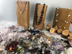 Large collection of new costume jewellery along with homemade wooden display stands (ideal for