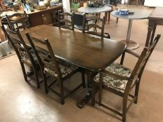 Ercol dining table and six ladder back chairs (two carvers) with detachable cushions, table approx