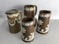 Collection of four Wedgewood Brown and white Jasperware jugs with rope effect handles