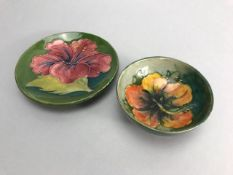 Moorcroft green hibiscus pattern dish, approx 11.5cm in diameter and a Moorcroft orange hibiscus