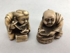 Two Japanese netsuke, both seated and dressed in robes, one eating noodles, approx 4cm in height