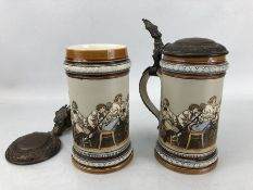 Pair of Mettlach, Villeroy and Boch Steins, with drinking scene, number 1146, with pewter lids.