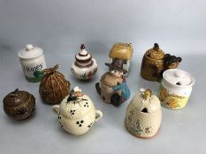 Small collection of eleven honey pots to include one by Price Bros.