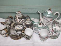 Light green lustre 6 piece oriental tea service and another brown ground decorative 6 piece service