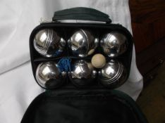 Set of 6 unused steel boules in green canvas carrying case