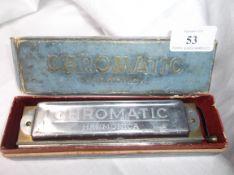 Boxed chromatic harmonica