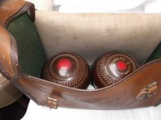 Pair of brown tyrolite lawn bowls with steel measure all in light brown plastic carrying case