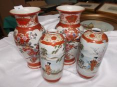 Pair of satsuma style urn shaped vases in traditional colours decorated Geisha Girls beside Acacia