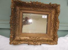 Wall mirror in ornate gilt frame