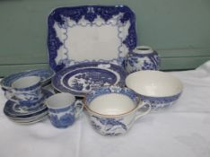 Tray of blue and white principally willow patterned ware