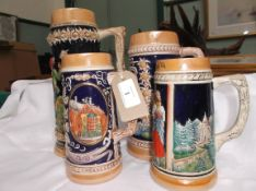 4 handled multi-coloured German stoneware ale mugs with raised multi-coloured decoration