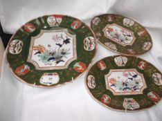 Multi-coloured dark green floral patterned meat plate and 2 smaller oval side dishes