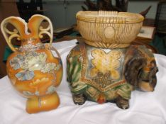 Large stoneware multicoloured elephant centre piece and a yellow and orange ground double handled