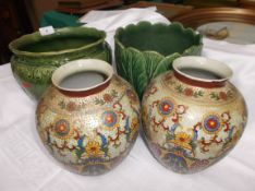 2 dark green bulb holders and a pair of satsuma style multi-coloured flower vases