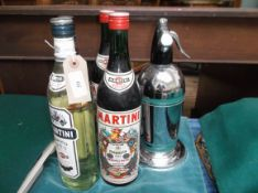 Mid 20th century plated soda syphon and stand and 4 bottles of Martini