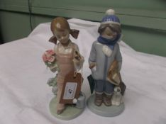 Lladro figure of a young girl with posy and bird in hands and another lladro figure of a young boy