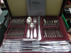 Unused German two tier set of stainless steel cutlery in maroon leather carry canteen