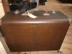 Mid 20th century converted electric sewing machine in brown snakeskin effect carrying case (model