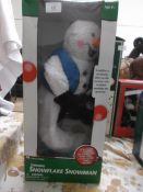 Unused boxed Christmas decoration of spinning snowflake snowman