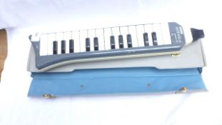 Hohner Melodica piano 26 keyboard in grey leather carrying case