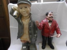 Plaster ornament of a moustached gentleman entertainer and another of a fisher boy