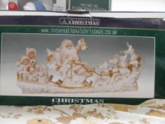Boxed Christmas International model of Santa with sleigh