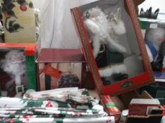 "Box of Christmas decorations incl. an unused 16"" sitting santa, fibre optic house, tablecloths etc."