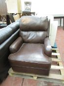 Leather Rocking manual reclining armchair, mechanism is working but there is a discoloured patch