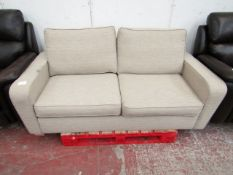 Beige fabric 2 seater sofa, in good condition but has a few dirty parts from storage, should clean