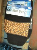 Set of 4 universal car mats, see picture for design, new and packaged.