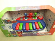 PJ Masks keyboard, new and in damaged packaging.